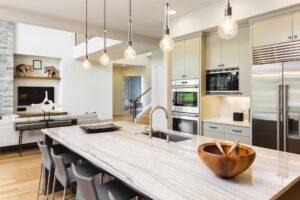 A kitchen with beautiful quartzite countertops. Quartz or quartzite is a beautiful kitchen countertop idea.