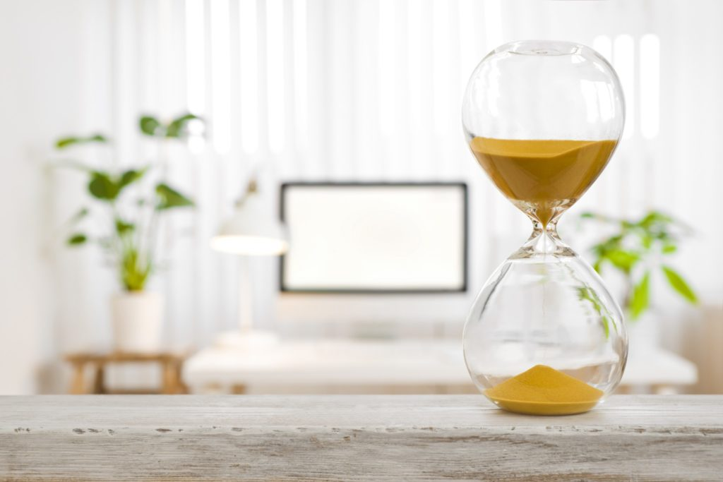 An hourglass with yellow sand