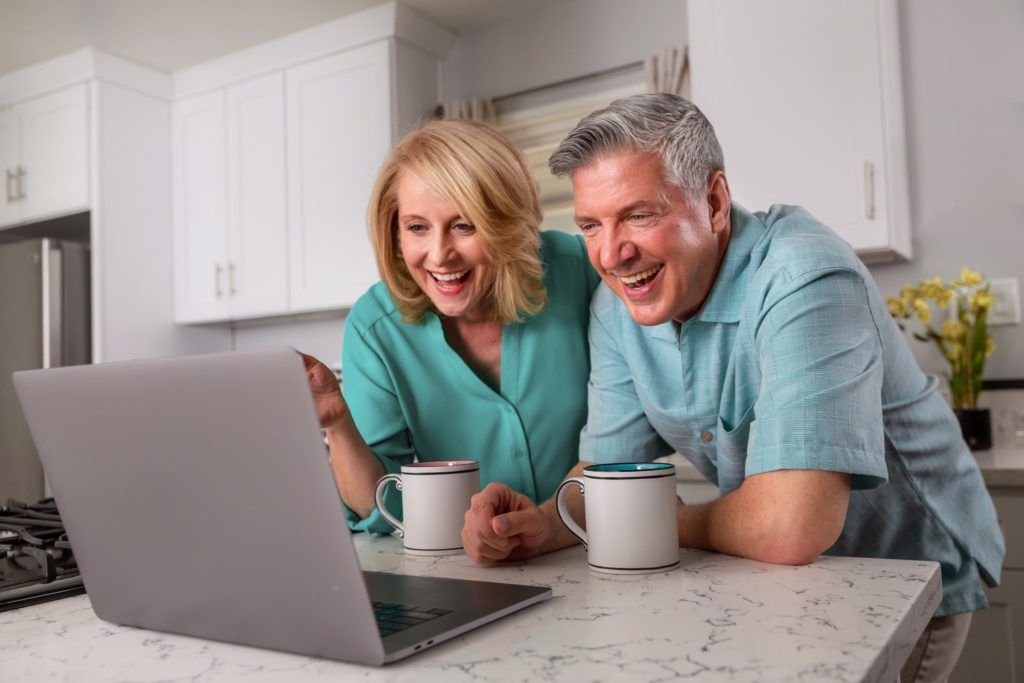 An older couple leaning on their warm stone counters from FeelsWarm