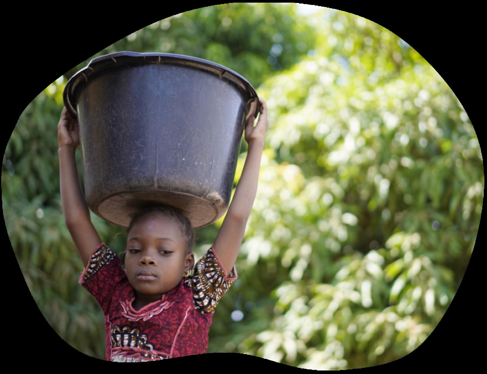 Child carrying large basin