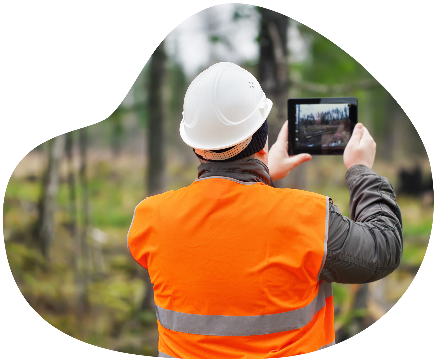 Person in hardhat and vest measuring collecting environmental data