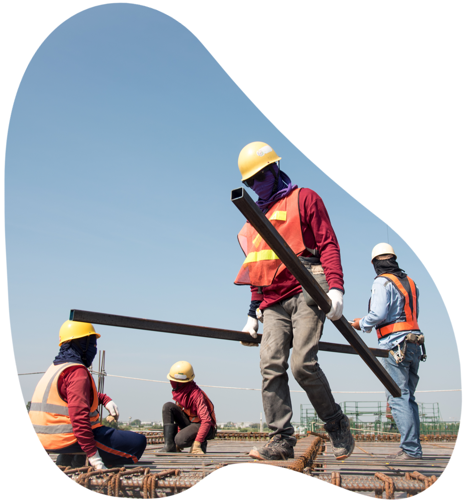 Construction workers carrying materials and working on-site