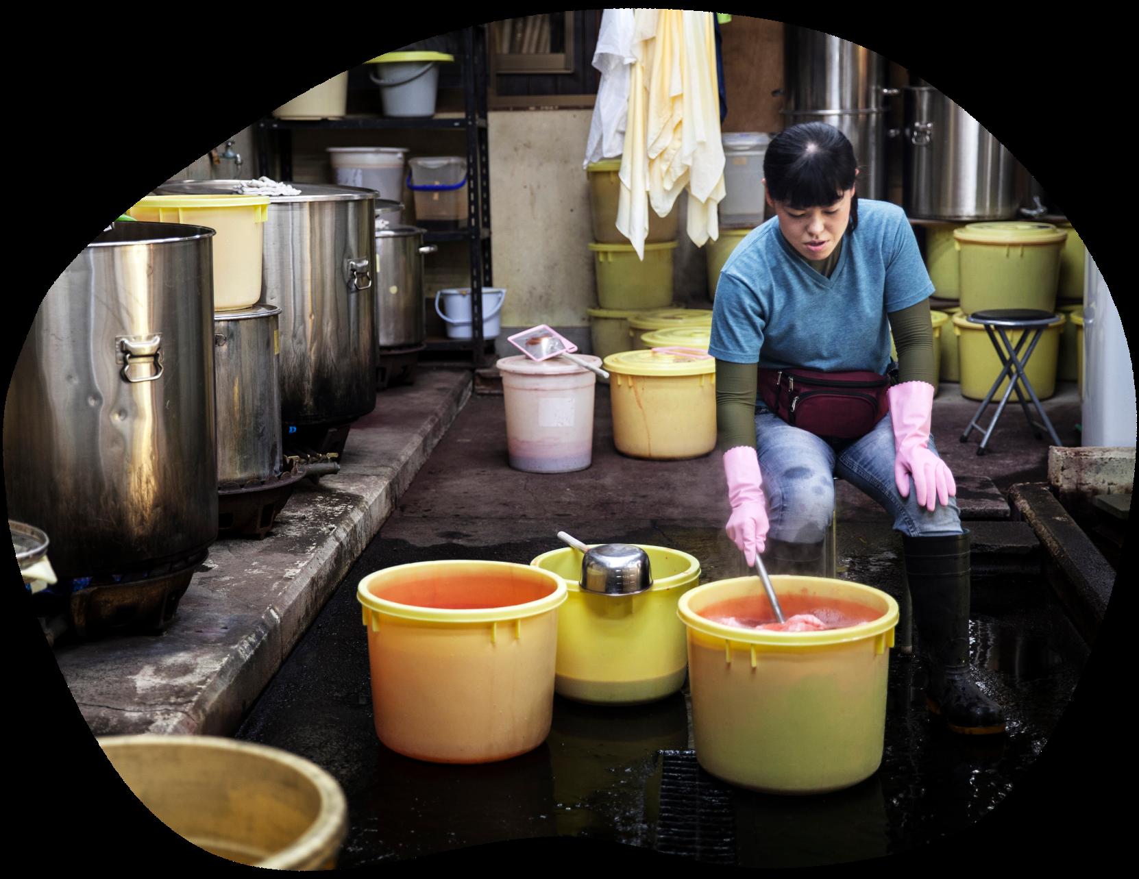 Woman dyeing garments
