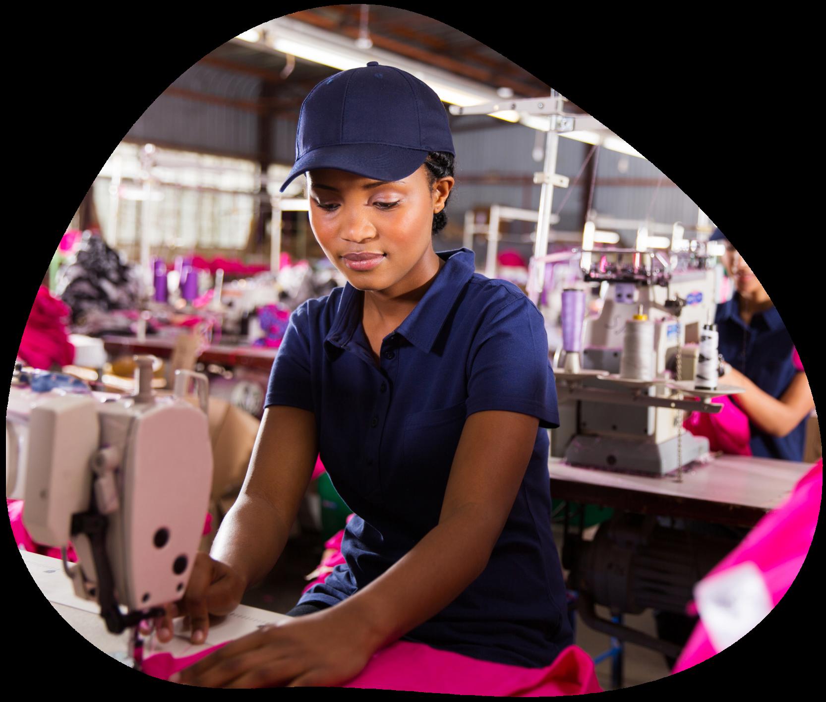 Woman operating sewing machine