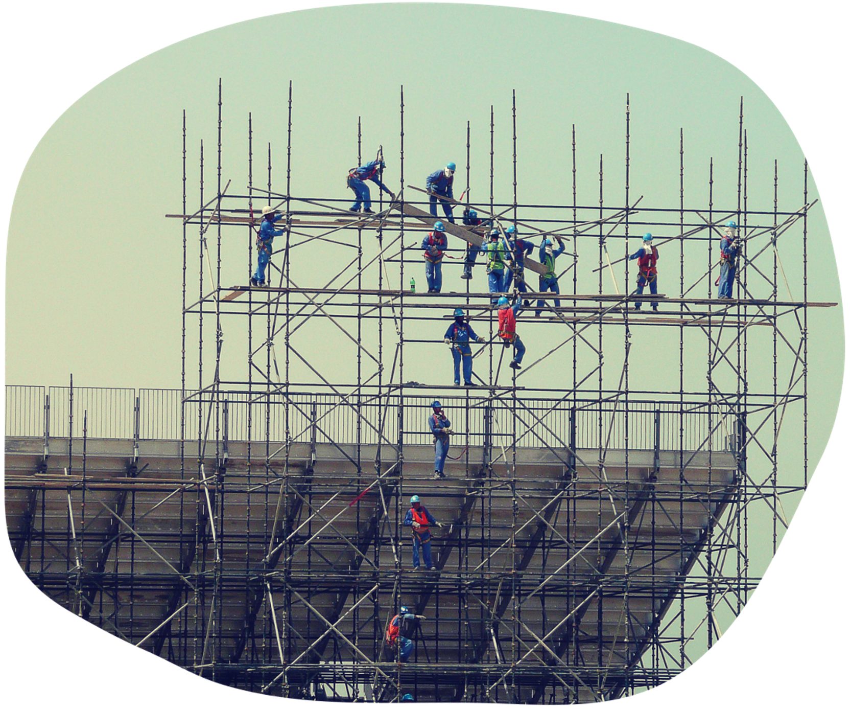 Workers constructing a stadium