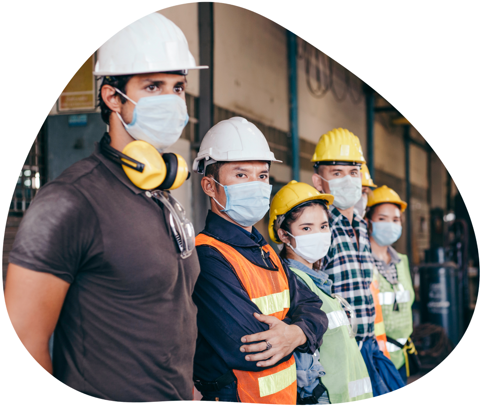 Lineup of construction workers wearing masks and hard hats