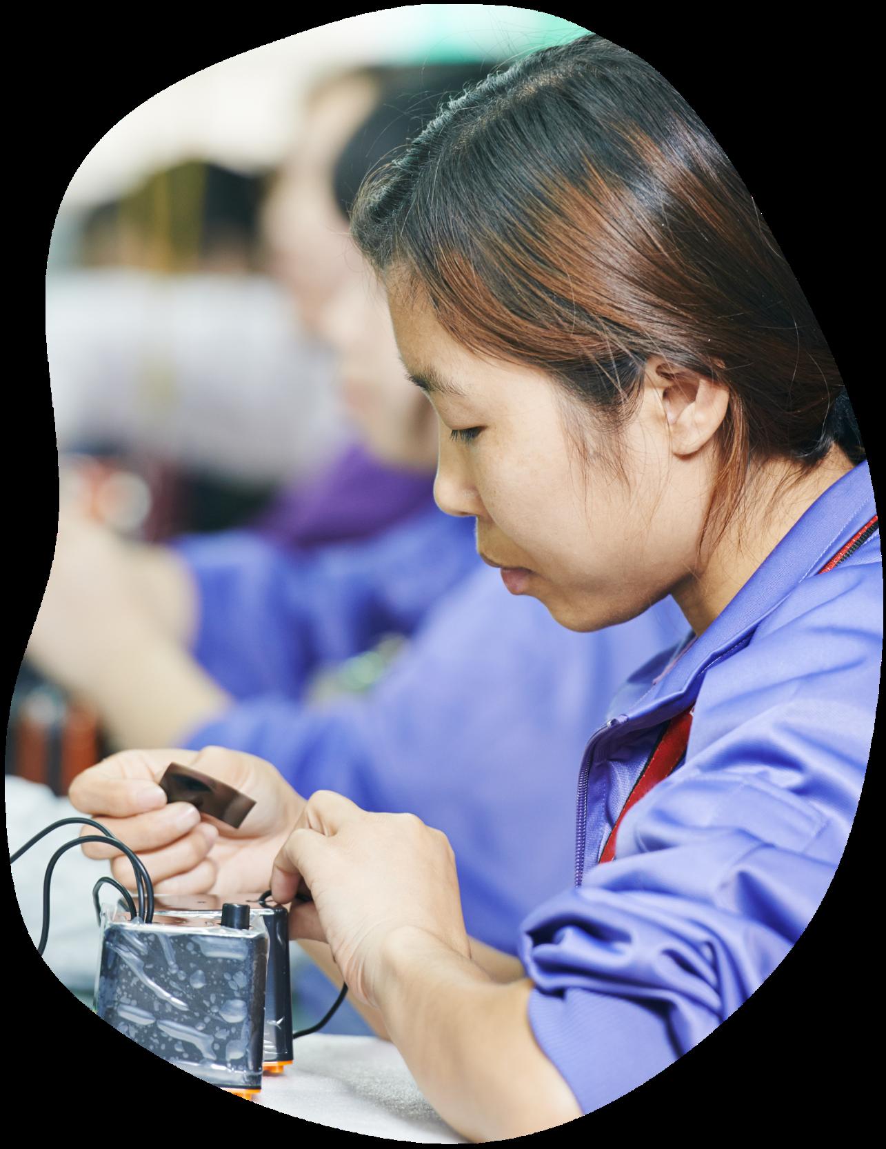 Woman making electronic item