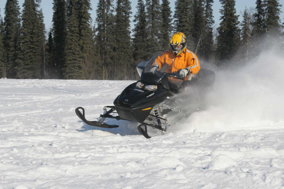 A man snowmobiling