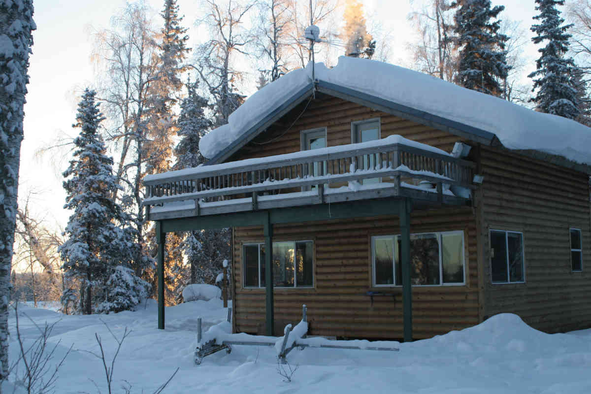 The lodge with the roof covered in snow