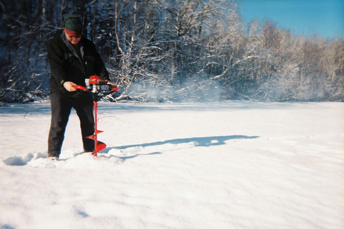 A person using an ice drill