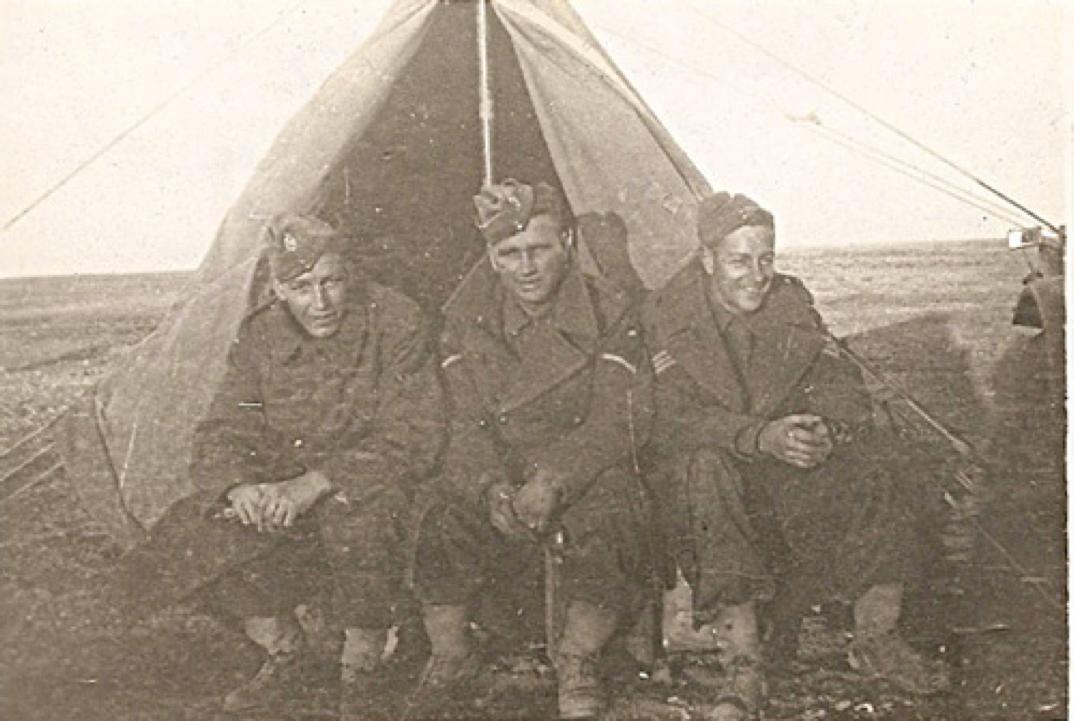Three soldiers in tent, N. African desert, Christmas 1941.