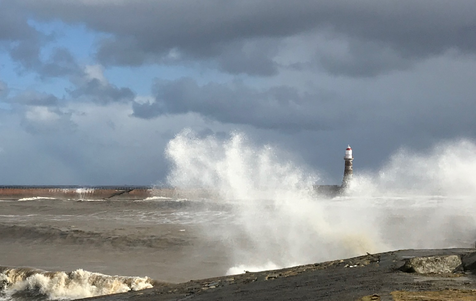 Photo: Michael Otterson. Roker lighthouse in storm, Sunderland, England
