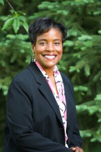Photo of woman in suit smiling at camera