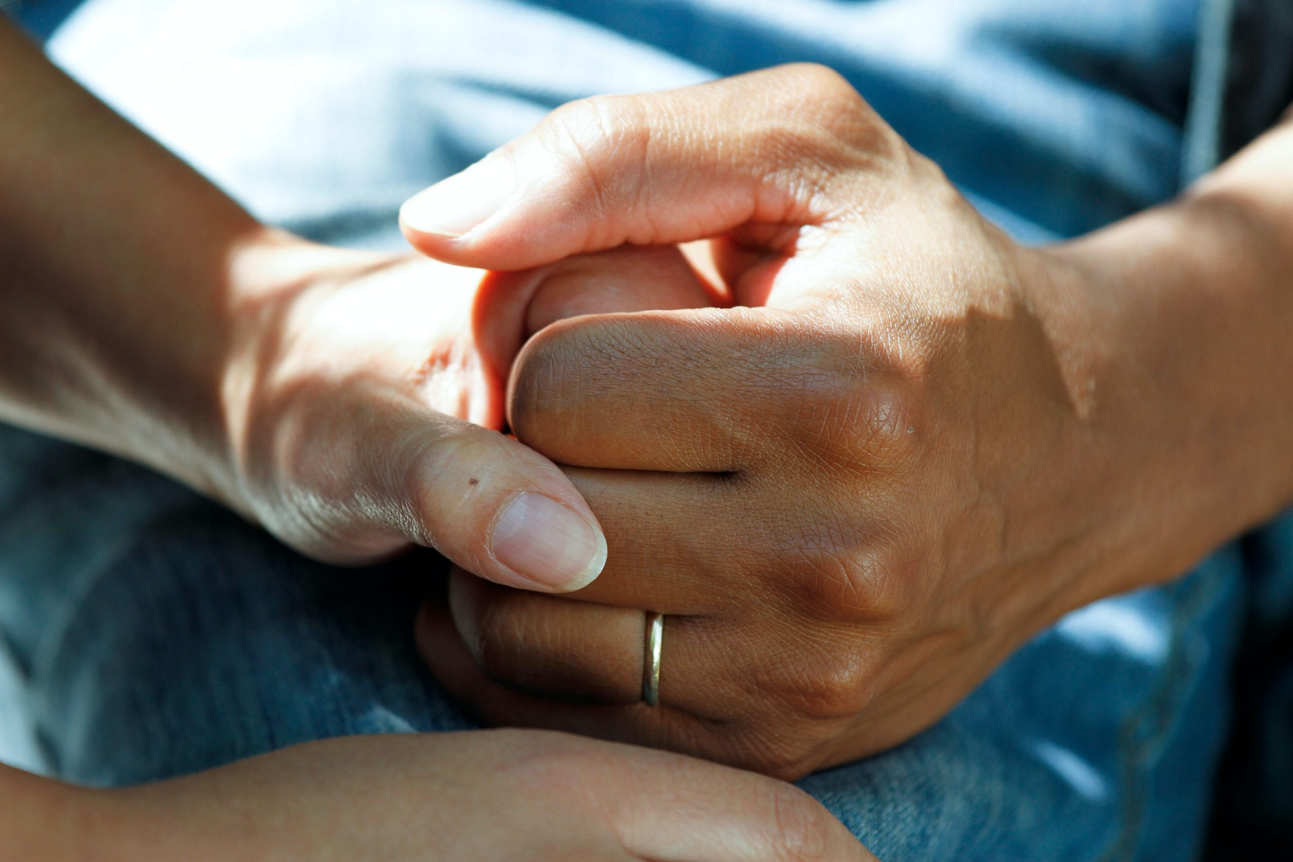 person wearing gold wedding band