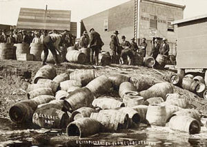 ATF confiscating illegal alcohol, in Elk Lake, Canada, in 1925.