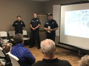 Fire fighters giving a presentation to a local community at their HOA meeting.