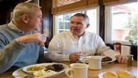 Senior Men Dining in Public