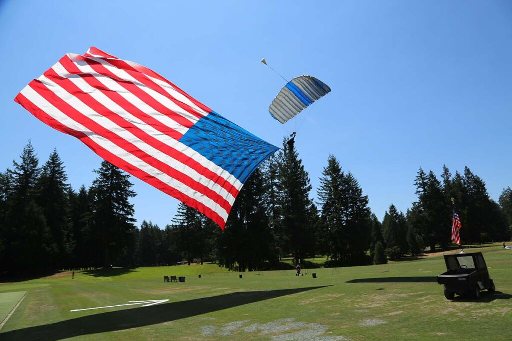 skydiving with the flag at the Swing For A Soldier