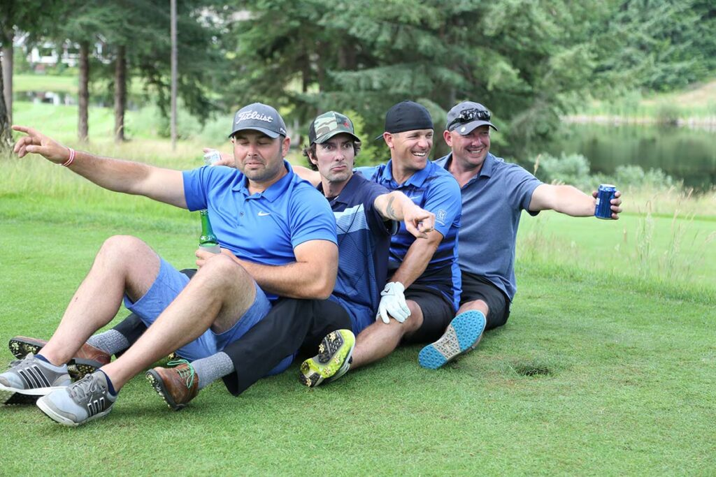 Four guys looking for the golf ball at the Swing For A Soldier