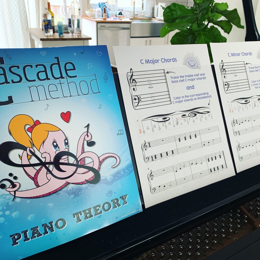 Cascade Method Piano Theory Book displayed on the piano