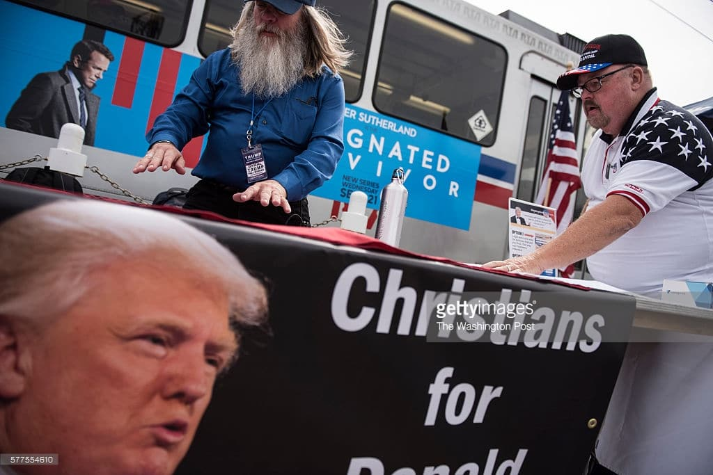 CLEVELAND, OH - JULY 18: David Servin, left, lays out pro-Trump literature prior to a rally at Settler's Landing near downtown Cleveland on July 18, 2016. (Photo by Michael Robinson Chavez/The Washington Post)