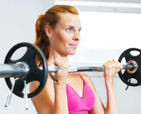 women exersizing with barbells