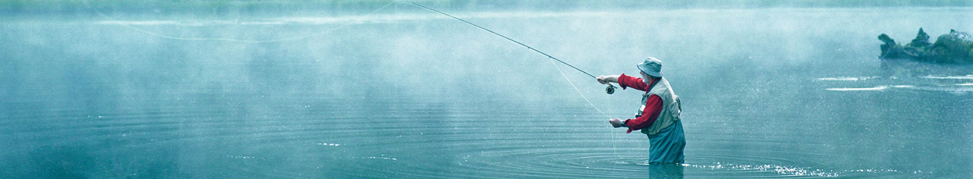 Banner image for Wealth Management Solutions.  Image is of a man fly fishing.