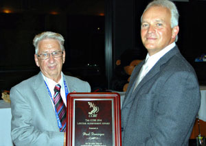 Paul Firminger (left) of Paris receives a lifetime achievement award from Denis Barriault, president of the Central Canada Broadcast Engineers.