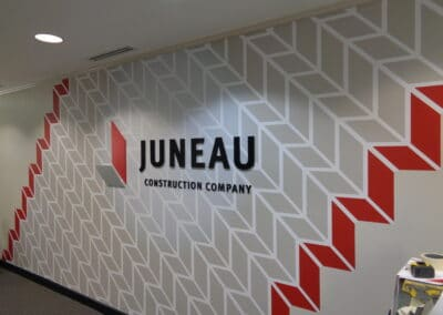 Juneau Construction Company Reception Custom Signage and Graphics by Option Signs