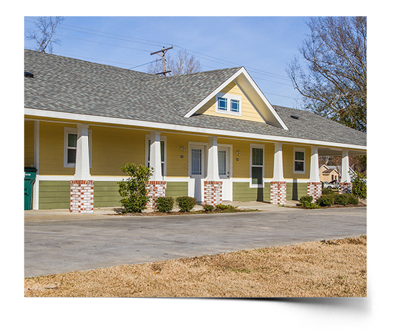 Designed to accommodate multiple tenants per unit, these duplexes fit nicely in the neighborhood with spacious porches, peaceful colors, and relaxed floor plans for multiple options of living styles.