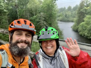 Guided Bike Tour pic in Northwoods on discontinued train trestle over the Namekagon in the rain.  Positive spirits, the spots, and the rain made the outdoor adventure!