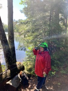 Guided Tour participant gets some Sun in front of an idyllic Northwoods lake spot after the storm cleared. Outdoor adventure!