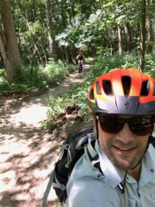 Riding bike in the woods is a great way to connect with our kids!