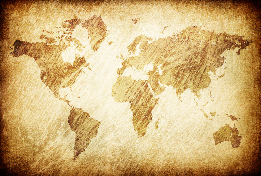 Grunge rubbed map of the world background.