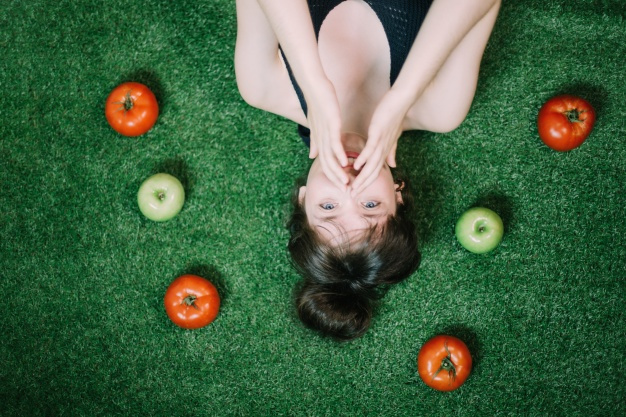 woman-amidst-apples-and-tomatoes_23-2147669568.jpg