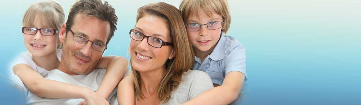 Family of Adults and Children all Wearing New Eyeglasses