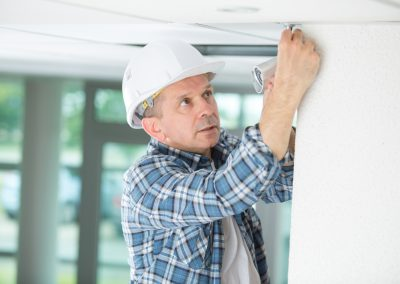 professional electrician replacing the light bulb at home