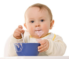 Toddler eating you from a blue bowl