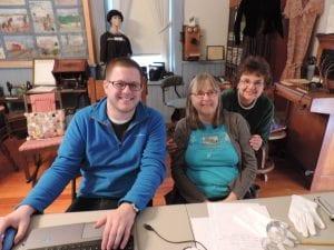 Erik Radowski, left, works with our volunteers Karen McConnell and Georgia Trammel