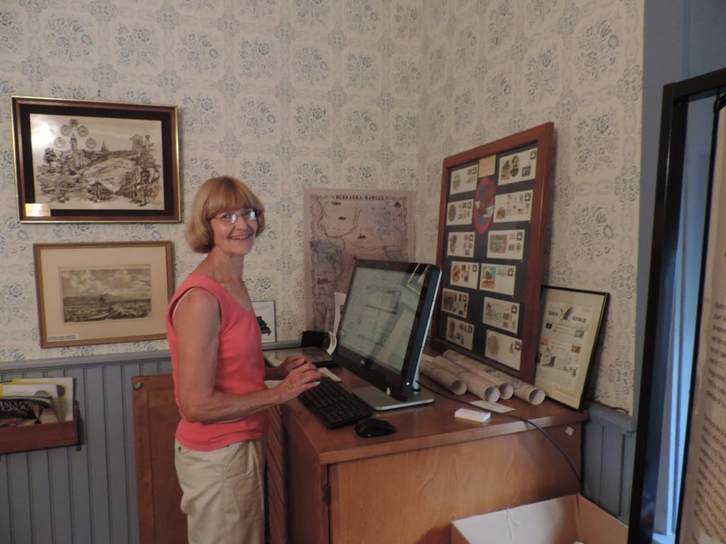 Donna Koepp, retired map librarian from the University of Kansas and Harvard, works on entering our map collection into the software.