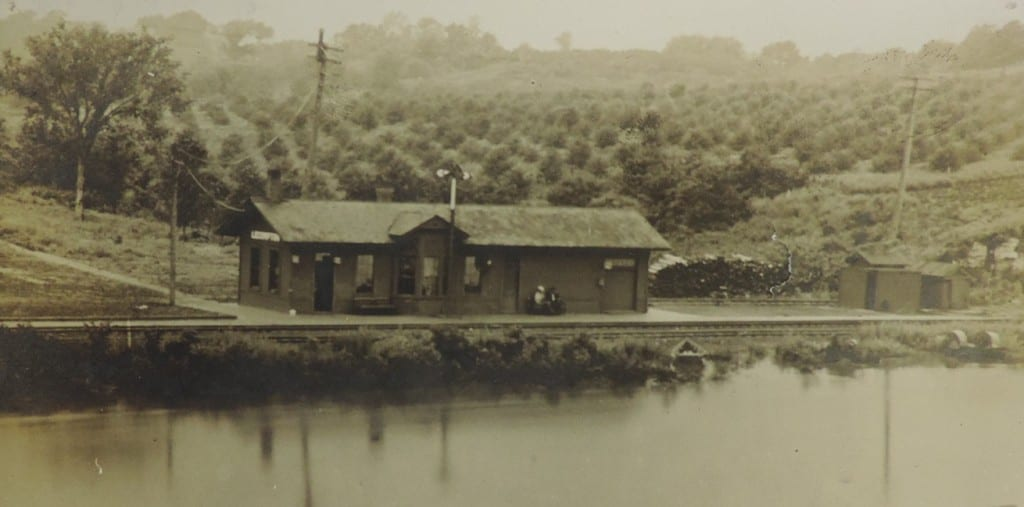 Train Depot Lecompton with orchard in background
