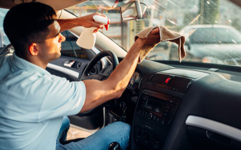 Man Cleaning Car Window With Cloth