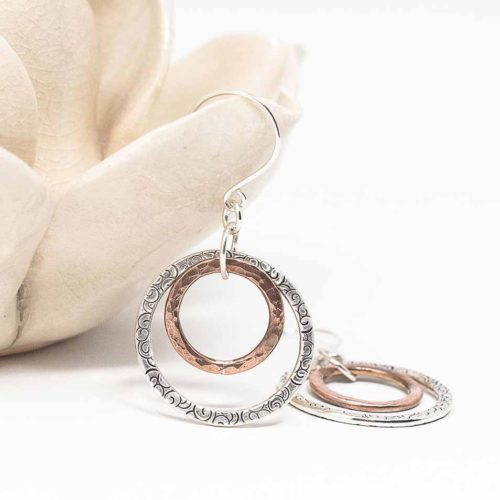 Hoops in sterling silver and copper on silver ear wire