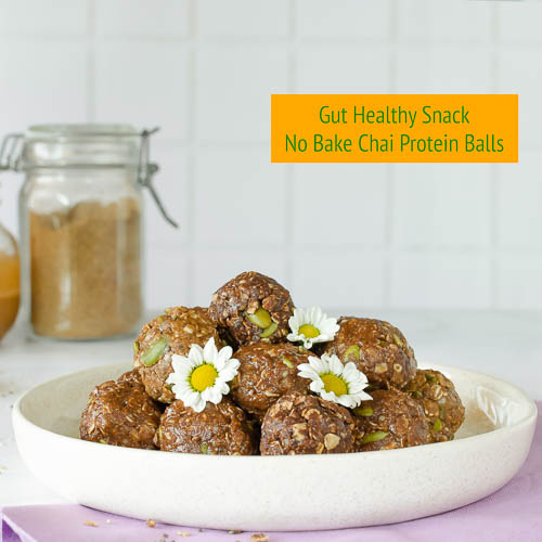 brown protein balls with white flower
