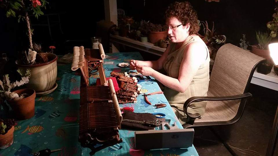 Repinning parts on an old church piano. The action had become sluggish and played very hard and notes weren