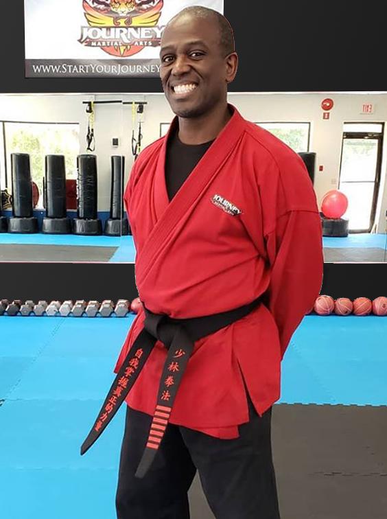 Master Clayton Johnson standing at ease in Journey Martial Arts dojo