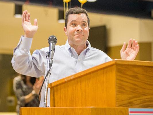Brian speaking at podium