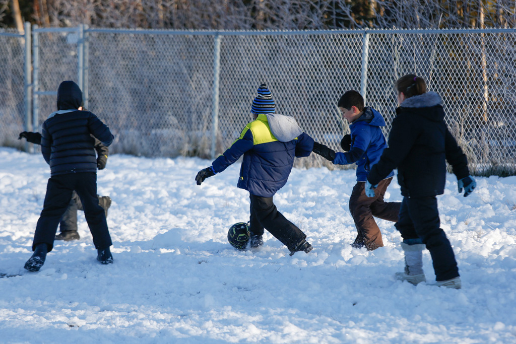 Students play outdoors in the Before and After School Program.