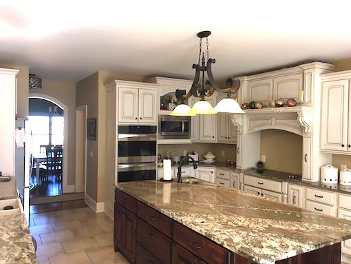 photo of granite countertop kitchen with white kitchens and built in stoves and gas stove