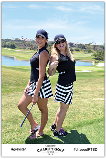two female golfers pose for photo during golf charity event